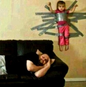 child taped to wall