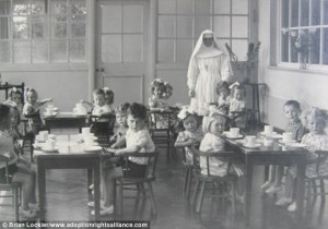 Dark secrets: Children at the tea room at Sean Ross Abbey in Tipperary eat under the stern gaze of a nun