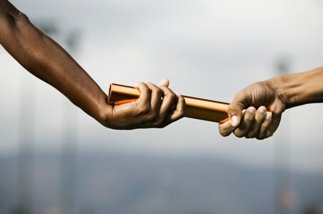 Hands Passing Baton