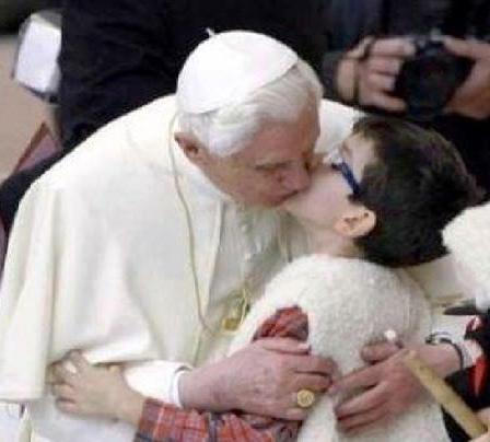 Former-Pope-Joseph-Ratzinger-kissing-a-young-parishioner