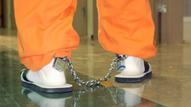 GETTY_N_062311_PrisonShacklesOrangeSuit