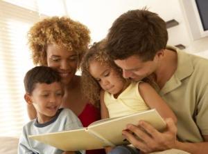 Mixed-race family reading
